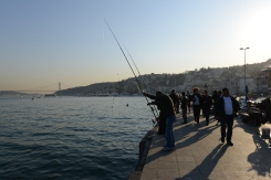 Fishing along the boardwalks and bridges is of the norm on the Bosphorus, where little silver finger-sized fish seem to congregate. Long lines are fitted with several hooks at once so fishers can fill their buckets faster.