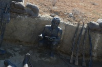 Here a soldier is displayed reading the Qur'an, which, apart from eating, sleeping, and fighting, was, according to signage, the only other way soldiers spent their time.
