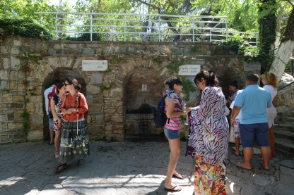 A well beneath the house. I didn't drink it, but it is said to have a salty taste and miraculous healing and fertility powers. The source apparently flowed in a little channel through Mary's room, and her presence blessed it forever. People had brought empty jugs and water bottles and were filling them to take to family and friends. Some people had twenty bottles to fill.
