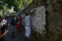 The wishing wall, where believers would write wishes and affirmations and resolutions on fabric or paper and tie it to the wall.