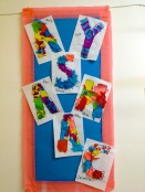 Initials decorated with tissue paper.